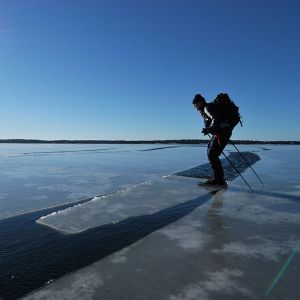 BMJRG1 A man ice skating on melting ice